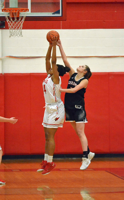 . Paul DiCicco - The News-Herald Chardon\'s Tori Butala (33) gets a hand on the shot of Mentor\'s Teagan Ochaya (44) on Feb 5.