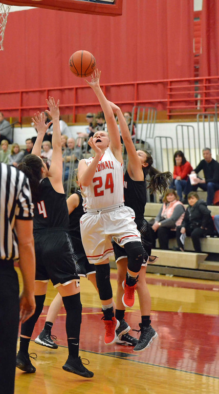 . Paul DiCicco - The News-Herald Mentor\'s Brooke Hickman (24), shoots over Chardon\'s Grace Bradley (4) on Feb 5.