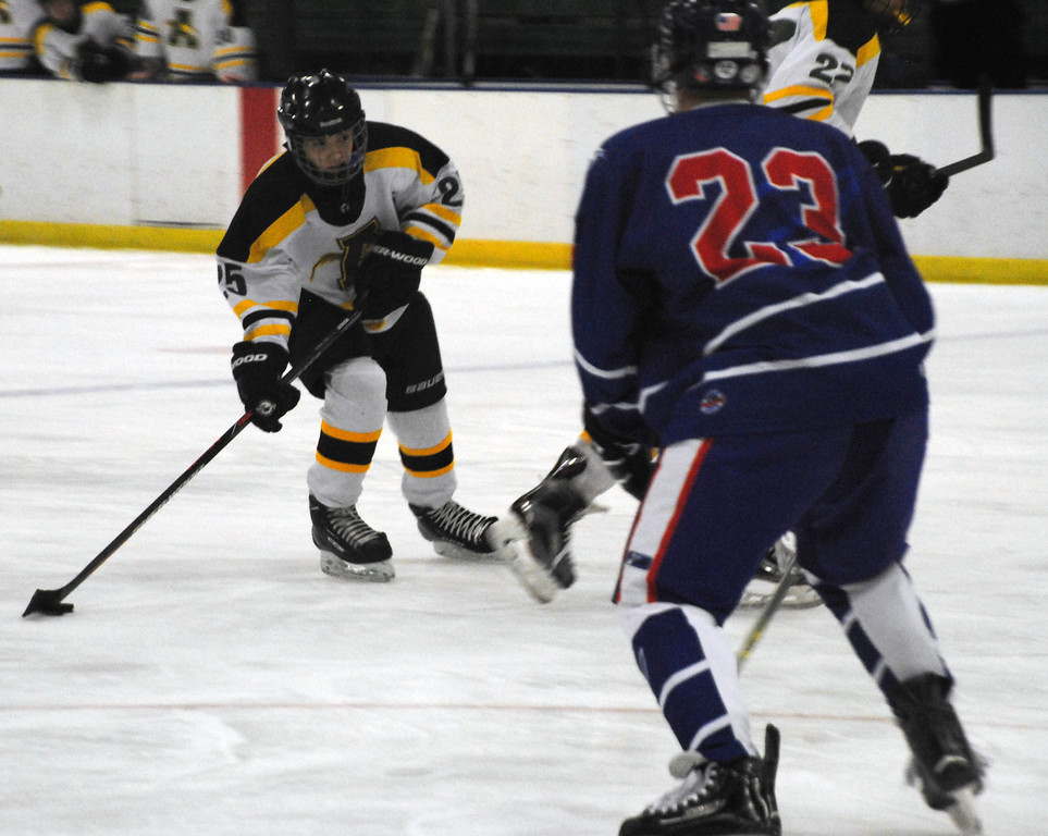 . Jon Behm - The Morning Journal<br> Amherst sophomore Jacob Kramer looks for an opening to take a shot agianst Bay during the first period of a Baron Cup II quarterfinal on Feb. 5 at Brooklyn\'s John M. Coyne Recreation Center.