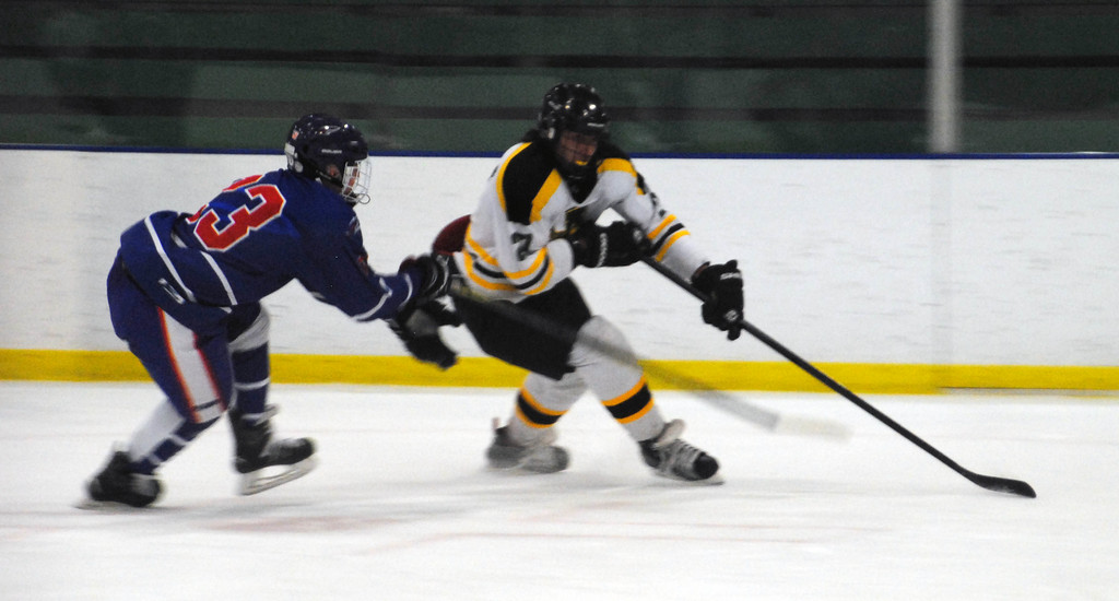 . Jon Behm - The Morning Journal<br> Amherst junior Michael Giannuzzi works to get around Bay\'s Will Kenney during the first period of a Baron Cup II quarterfinal on Feb. 5 at Brooklyn\'s John M. Coyne Recreation Center.