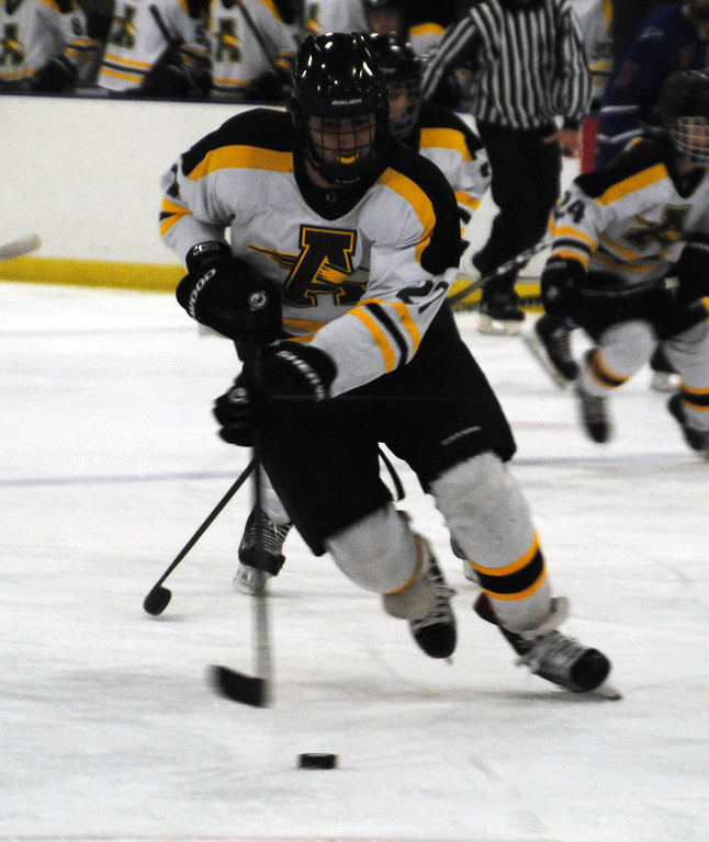 . Jon Behm - The Morning Journal<br> Amherst junior Michael Giannuzzi brings the puck up ice against Bay during the first period of a Baron Cup II quarterfinal on Feb. 5 at Brooklyn\'s John M. Coyne Recreation Center.