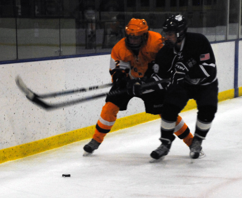 . Jon Behm - The Morning Journal<br> Avon Lake\'s Colin Reynolds battles with Twinsburg\'s Anthony Sciarabba for the puck during the first period of a Baron Cup III quarterfinal on Feb. 5 at Brooklyn\'s John M. Coyne Recreation Center.