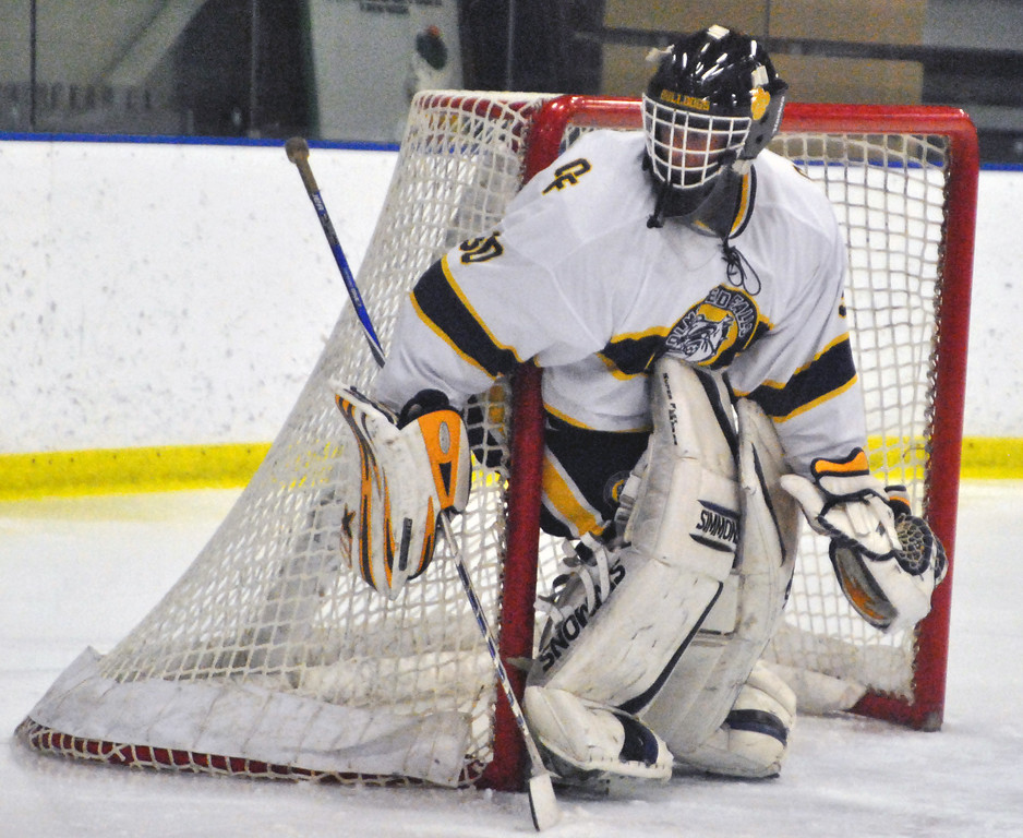 . Jon Behm - The Morning Journal Olmsted Falls goalie Zach Snyder protects his post as Parma advances the puck during the second period of a Baron Cup II quarterfinal at Brooklyn\'s John M. Coyne Recreation Center on Feb. 7. Snyder had 36 saves in the shutout.