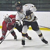 Jon Behm - The Morning Journal<br /> Olmsted Falls sophomore Dom Conte shoots the puck as Parma's Owen Athur (12) watches during the first period of a Baron Cup II quarterfinal at Brooklyn's John M. Coyne Recreation Center on Feb. 7.