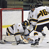 Jon Behm - The Morning Journal<br /> Olmsted Falls goalie Zach Snyder covers the puck during the second period against Parma in a Baron Cup II quarterfinal at Brooklyn's John M. Coyne Recreation Center on Feb. 7. Snyder had 36 saves in the shutout.