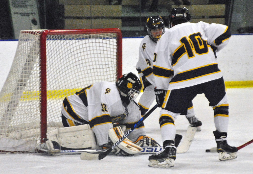 . Jon Behm - The Morning Journal Olmsted Falls goalie Zach Snyder covers the puck during the second period against Parma in a Baron Cup II quarterfinal at Brooklyn\'s John M. Coyne Recreation Center on Feb. 7. Snyder had 36 saves in the shutout.