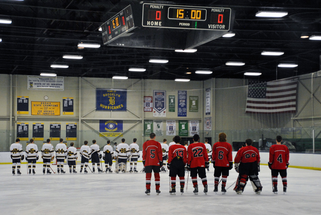 . Jon Behm - The Morning Journal Parma and Olmsted Falls stand during the National Anthem prior to their Baron Cup II quarterfinal at Brooklyn\'s John M. Coyne Recreation Center on Feb. 7.
