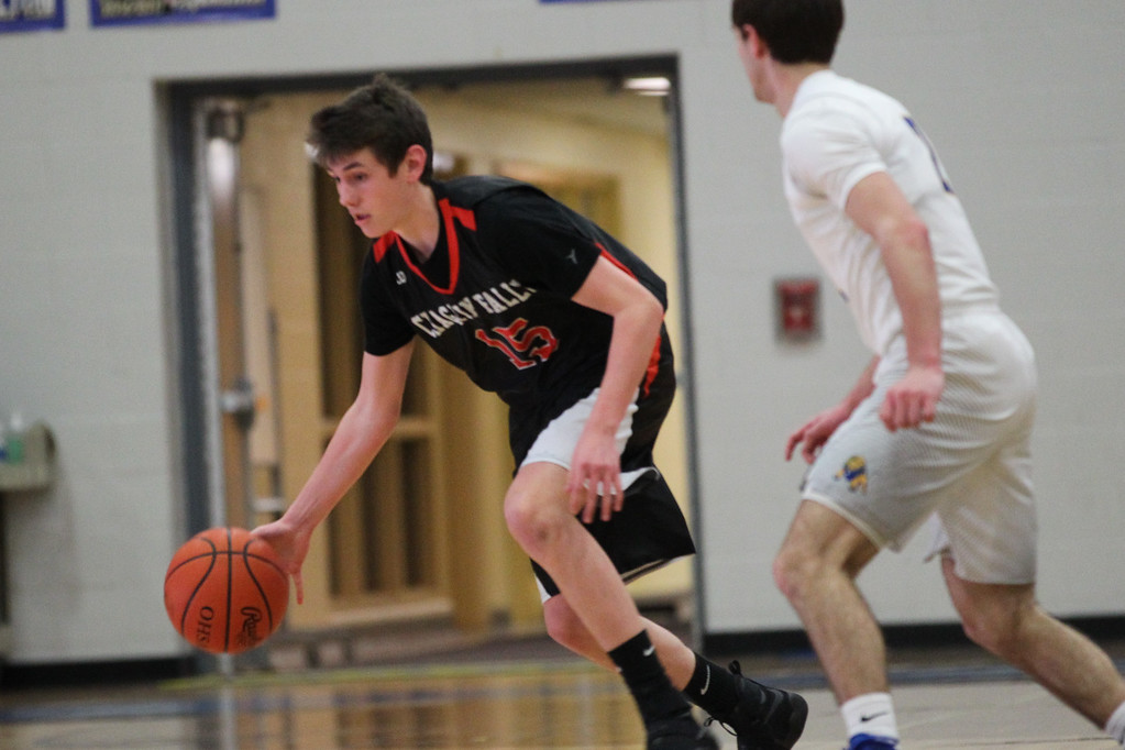 . David Turben - The News-Herald 2017 - Basketball - Chagrin Falls at NDCL - Night 2.  Chagrin Falls defeated NDCL 57-54 when play resumed the night after a power outage at NDCL had caused the game to be suspended.  Chagrin Falls\' Mason Bartlett (15) moves up court.