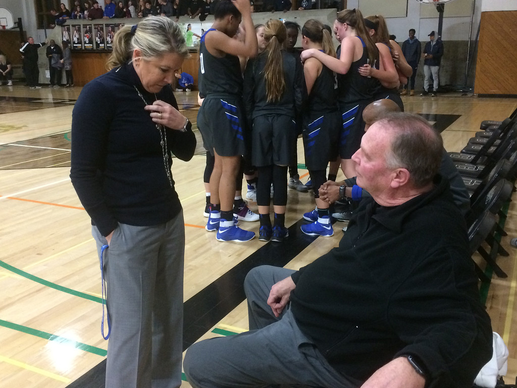 . John Kampf - The News-Herald Gilmour girls basketball coach Bob Beutel talks with assistant coach Claudia Beutel during a break against Hathaway Brown on Feb. 8 in Shaker Heights.
