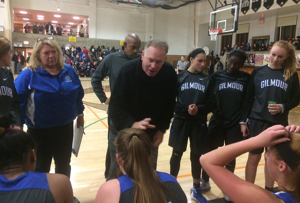 . John Kampf - The News-Herald Gilmour girls basketball coach Bob Beutel talks to the team during a break against Hathaway Brown on Feb. 8 in Shaker Heights.