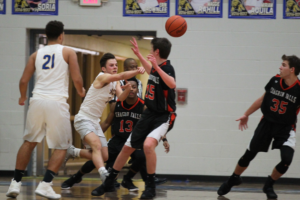 . David Turben - The News-Herald 2017 - Basketball - Chagrin Falls at NDCL - Night 2.  Chagrin Falls defeated NDCL 57-54 when play resumed the night after a power outage at NDCL had caused the game to be suspended.  NDCL\'s Sam Perovsek (1) makes a strong pass across the court.