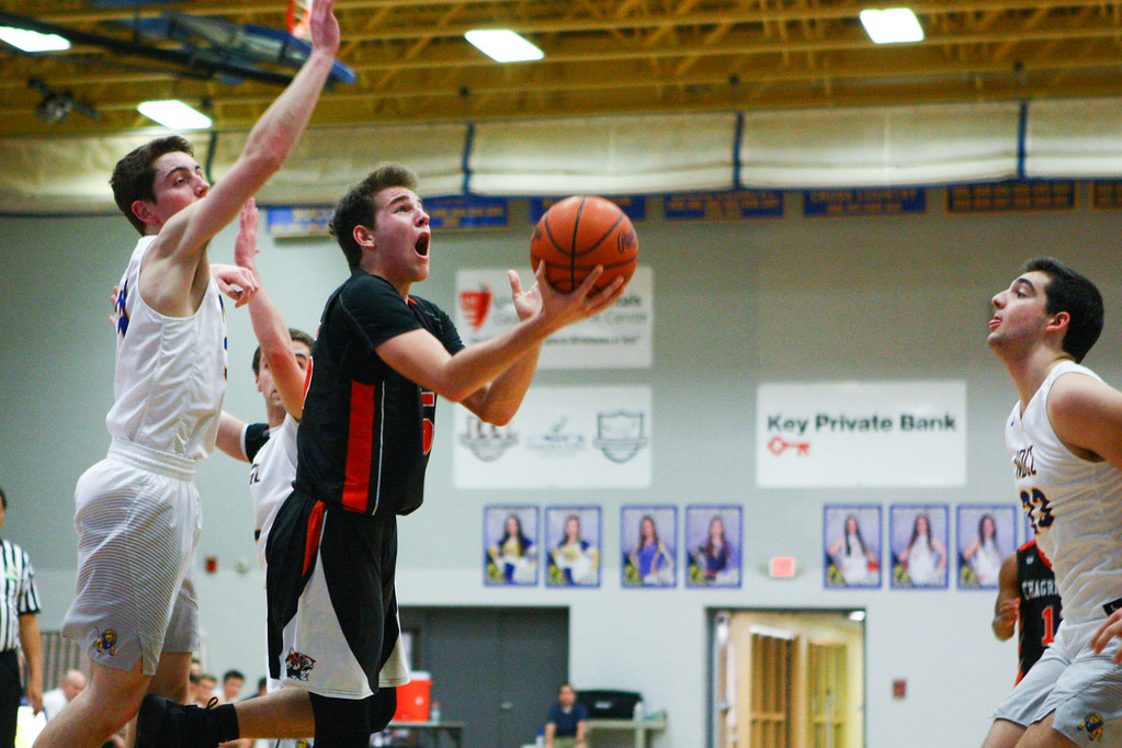 . David Turben - The News-Herald 2017 - Basketball - Chagrin Falls at NDCL - Night 2.  Chagrin Falls defeated NDCL 57-54 when play resumed the night after a power outage at NDCL had caused the game to be suspended.  Chagrin Falls\' Jenson Yonker (35) drives to the basket past NDCL defender Jacob Petti (34).
