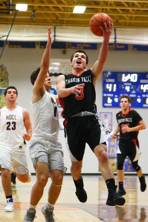 . David Turben - The News-Herald 2017 - Basketball - Chagrin Falls at NDCL - Night 2.  Chagrin Falls defeated NDCL 57-54 when play resumed the night after a power outage at NDCL had caused the game to be suspended.  Chagrin Falls\' Will Bargar (3) drives for a layup past NDCL defender Sam Perovsek (1).