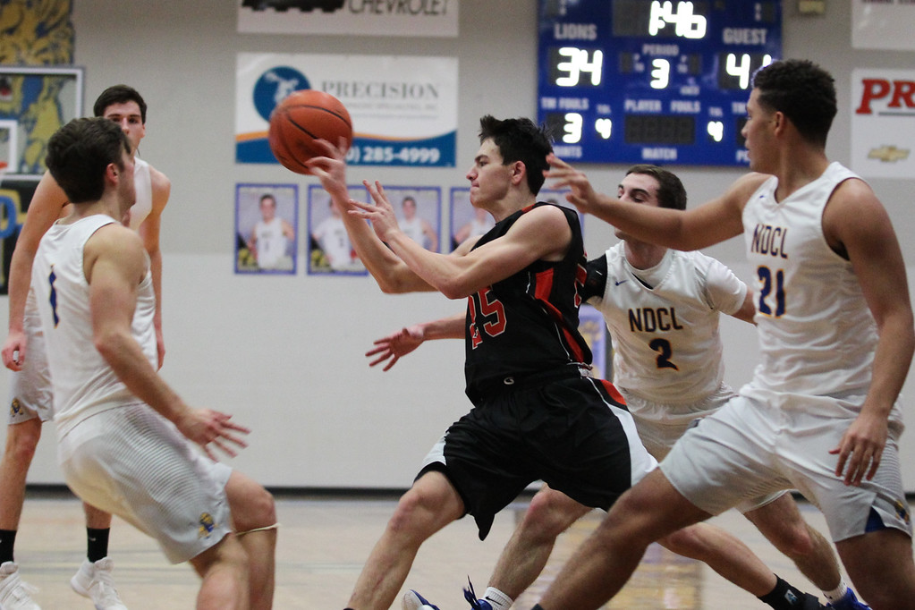 . David Turben - The News-Herald 2017 - Basketball - Chagrin Falls at NDCL - Night 2.  Chagrin Falls defeated NDCL 57-54 when play resumed the night after a power outage at NDCL had caused the game to be suspended.  Chagrin Falls\' Will DiFiore (25) drives to the key before making a kick-out pass to a teammate on the perimeter for a three-point attempt.