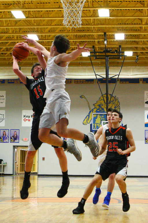 . David Turben - The News-Herald 2017 - Basketball - Chagrin Falls at NDCL - Night 2.  Chagrin Falls defeated NDCL 57-54 when play resumed the night after a power outage at NDCL had caused the game to be suspended.  Chagrin Falls\' Mason Bartlett (15) goes up for a shot against NDCL defender Sam Perovsek (1).