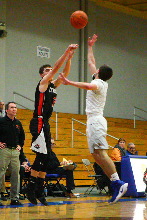 . David Turben - The News-Herald 2017 - Basketball - Chagrin Falls at NDCL - Night 2.  Chagrin Falls defeated NDCL 57-54 when play resumed the night after a power outage at NDCL had caused the game to be suspended.  Chagrin Falls\' Adam Bencko (2) goes up for a three-pointer over NDCL defender Ryan McMahon (2).