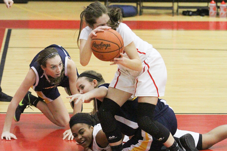 Barry Booher - The News-Herald<br /> Jillian Hach comes out of the pile with the loose ball.