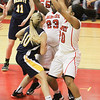 Barry Booher - The News-Herald<br /> Harvey's (23) Ayla Sheffey and (20) Na'Tori Ducksworth double team Ana Stepanovic.