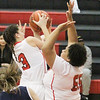 Barry Booher - The News-Herald<br /> Nakayla Cruz pulls a rebound away from teammate Makenna Lilly.