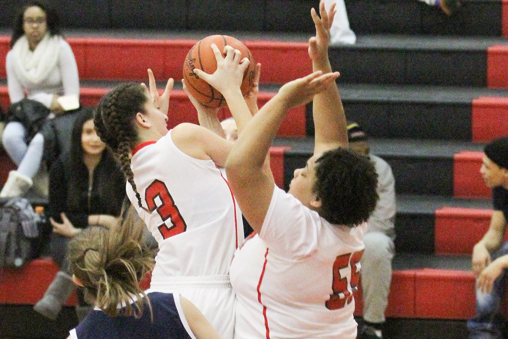 . Barry Booher - The News-Herald Nakayla Cruz pulls a rebound away from teammate Makenna Lilly.