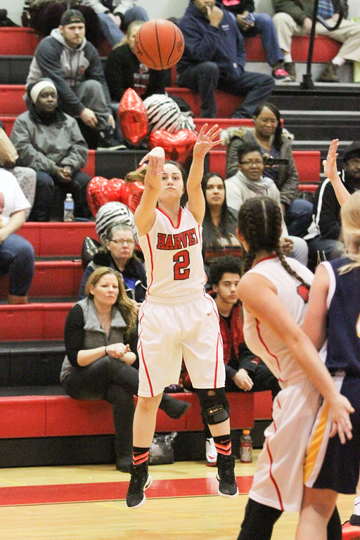 . Barry Booher - The News-Herald Danielle Cruz launches a three pointer.