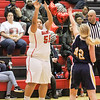 Barry Booher - The News-Herald<br /> Makenna Lilly shoots a three over Hannah Levon.
