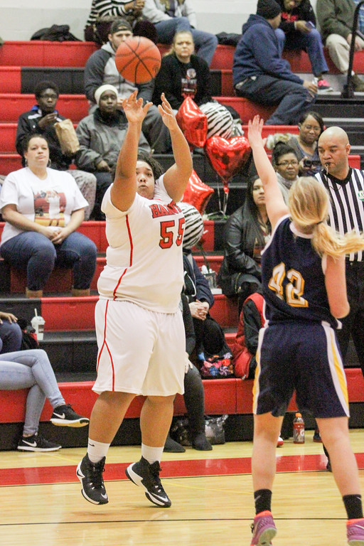 . Barry Booher - The News-Herald Makenna Lilly shoots a three over Hannah Levon.