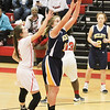 Barry Booher - The News-Herald<br /> Wickliffe's Nicole Carroscia takes a shot against Jillian Hach.