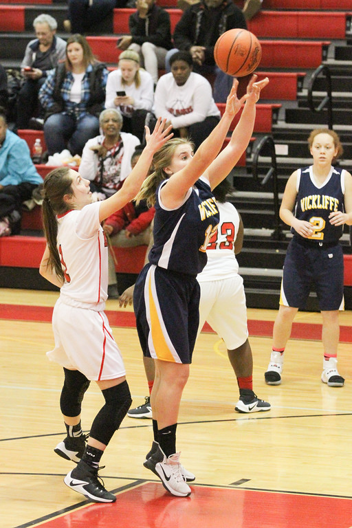 . Barry Booher - The News-Herald Wickliffe\'s Nicole Carroscia takes a shot against Jillian Hach.