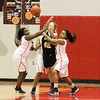 Barry Booher - The News-Herald<br /> Harvey's (left) Ayla Sheffey and Na'Tori Duckworth pressure Wickliffe's Hannah Levon.