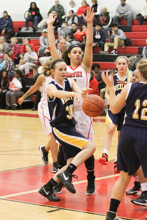 . Barry Booher - The News-Herald Harvey\'s Nevada Melton forces Bridgette Burkett, to pass the ball.