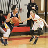 Barry Booher - The News-Herald<br /> Wickliffe's Stephanie Martin, dribbles around Jillian Hach.