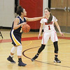 Barry Booher - The News-Herald<br /> Wickliffe freshman point guard Stephanie Martin, directs traffic while Jillian Hach defends her.