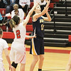 Barry Booher - The News-Herald<br /> Wickliffe's Mary Burkett, shoots against Danielle Cruz.