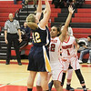 Barry Booher - The News-Herald<br /> Wickliffe's Nicole Carroscia takes a shot over LaTresha Epps.