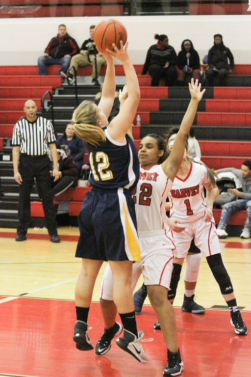 . Barry Booher - The News-Herald Wickliffe\'s Nicole Carroscia takes a shot over LaTresha Epps.
