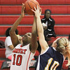 Barry Booher - The News-Herald<br /> Wickliffe's Ana Stepanovic blocks the shot of Harvey's Janiya Smith.