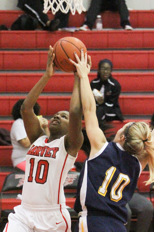 . Barry Booher - The News-Herald Wickliffe\'s Ana Stepanovic blocks the shot of Harvey\'s Janiya Smith.