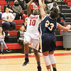 Barry Booher - The News-Herald<br /> Harvey's Janiya Smith scores over Wickleffe's Stephanie Martin.