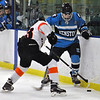 Jon Behm - The Morning Journal<br /> Kenston senior Will Mulhern works to get the puck past North Olmsted freshman Shawn Donovan (13) during the second period of a Baron Cup I quarterfinal at Brooklyn's John M. Coyne Recreation Center on Feb. 9.