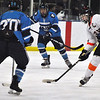 Jon Behm - The Morning Journal<br /> North Olmsted senior Shane Malinak winds up for a shot as Kenston junior John Barto defends during the third period of a Baron Cup I quarterfinal at Brooklyn's John M. Coyne Recreation Center on Feb. 9.