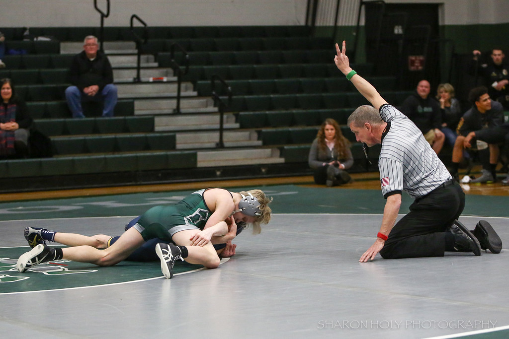 . Sharon Holy - The News-Herald Lake Catholic\'s Conor McCrone wrestles an opponent from St. Ignatius on Feb. 9.