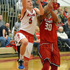 Paul DiCicco - The News-Herald<br /> Mentor's Jack Korsok drives to the basket, beating a fast Glenville defense.