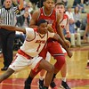 Paul DiCicco - The News-Herald<br /> Mentor's Allen Sims boxes out a Glenville defender.