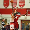 Paul DiCicco - The News-Herald<br /> Opening tip as the Mentor Cardinals host the visiting Glenville Tarblooders.  Mentor went on to win 62-39.