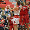Paul DiCicco - The News-Herald<br /> Mentor's Tadas Tatarunas driving to the basket against a tough Glenville defense.