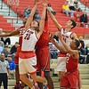Paul DiCicco - The News-Herald<br /> Mentor's Tadas Taturunas working for a rebound against Glenville.