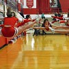 Paul DiCicco - The News-Herald<br /> Mentor Cheerleaders warming up before their home game against the Glenville Tarblooders on Feb 11.