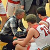 Paul DiCicco - The News-Herald<br /> Mentor Coach Bob Krizancic talks to his team between the third and fourth quarter in tonight's win against Glenville, 62-39.