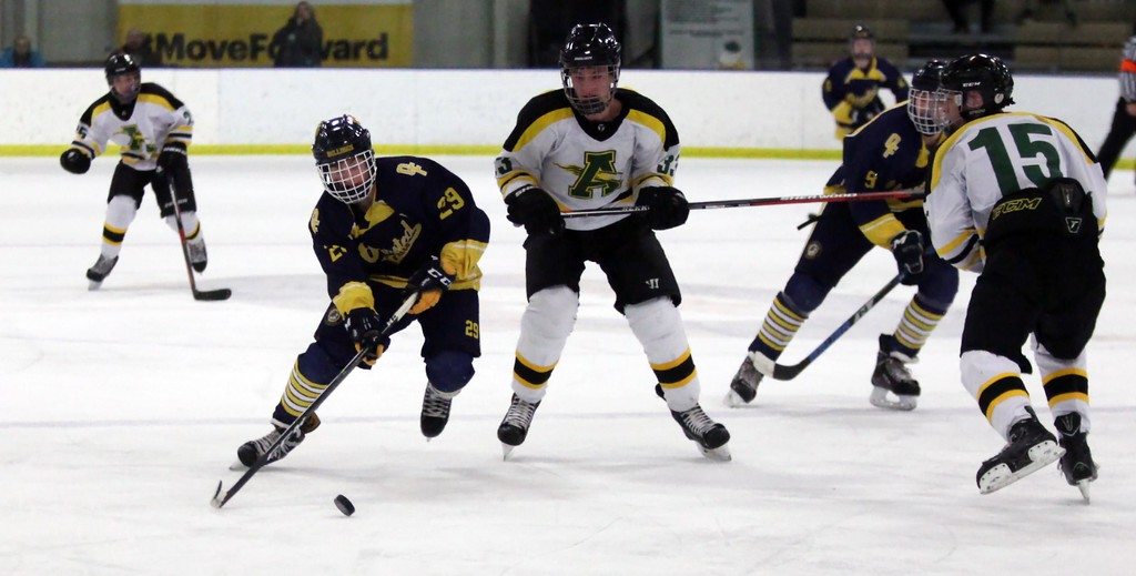 . Randy Meyers - The Morning Journal<br> Brady Fitzpatrick of Olmsted Falls weaves through the Amherst defense during the first period of the Baron Cup II final on Feb. 11.